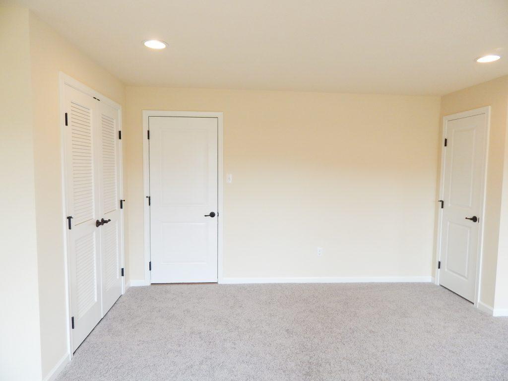 empty wall with doors mudroom