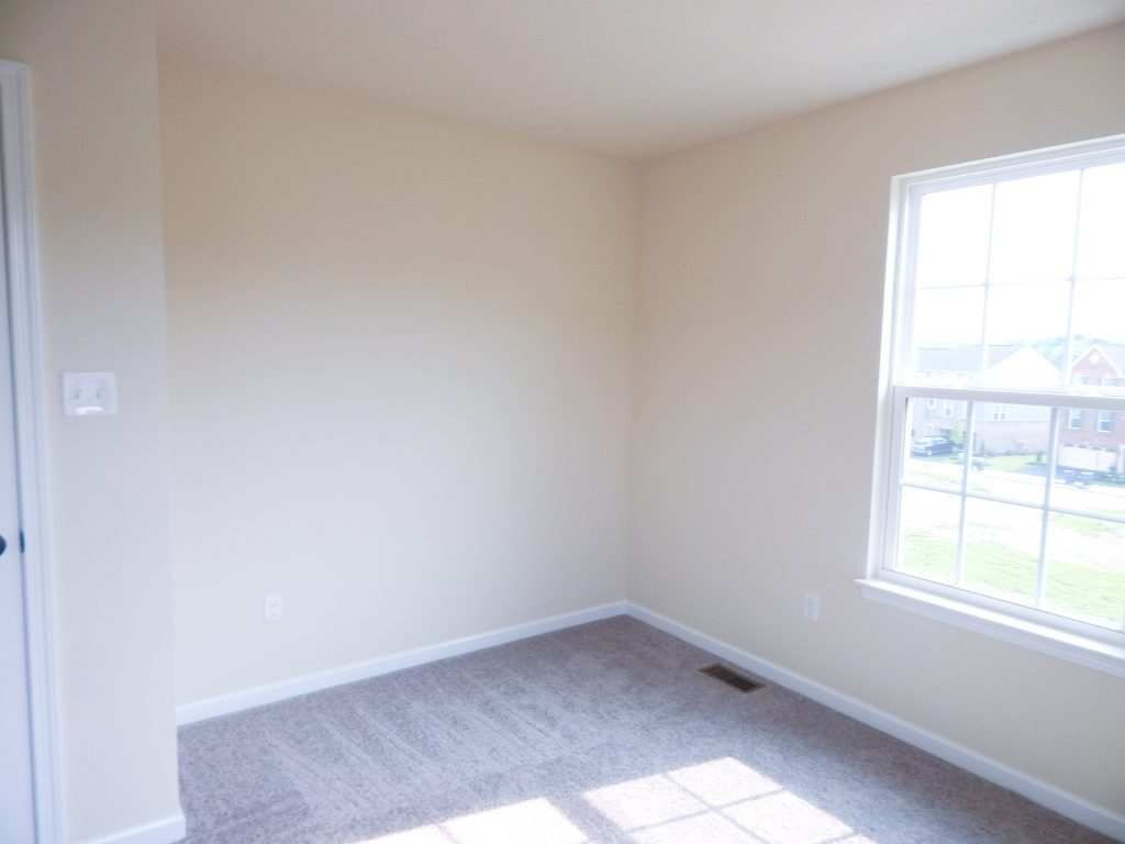 empty room with cream yellow walls
