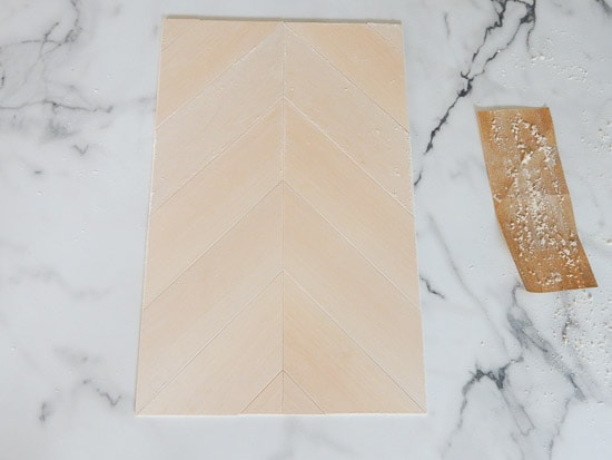 Sanding DIY Herringbone Sign