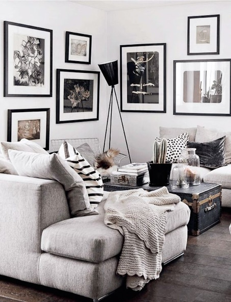 living room with black and white gallery wall