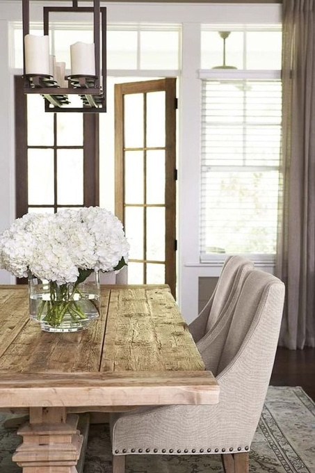 dining room with wooden table and upholstered chairs