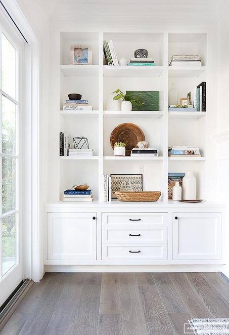 bright white built in bookshelves and home decor styling shelves