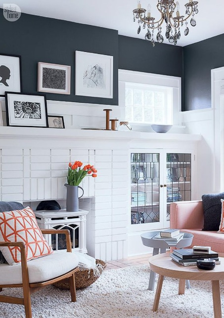 modern and bright white and gray living room with orange accents