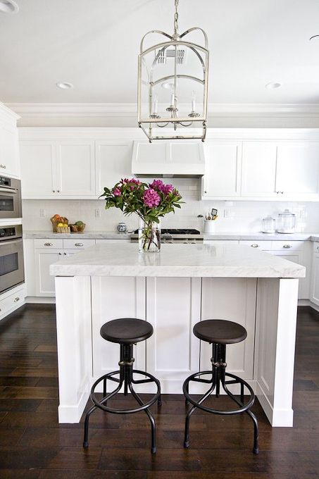 modern bright white kitchen with marble counters
