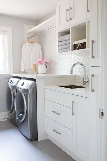 bright white laundry room with clean lines and modern design