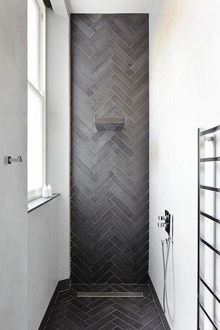 modern bathroom with herringbone gray tile shower