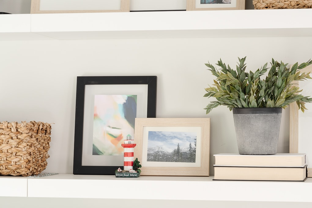 shelf decor with picture frames and mementos