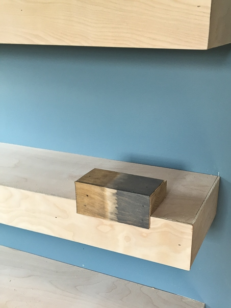 Step by step tutorial for building amazing floating shelves for an industrial masculine office. These only cost her $150 to build!