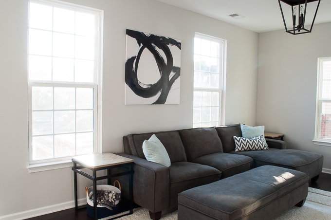 I love this modern black and white abstract art in the living room! Bold and beautiful!
