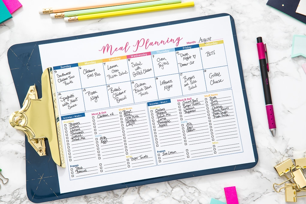 printable colorful meal planner on a desk with accessories