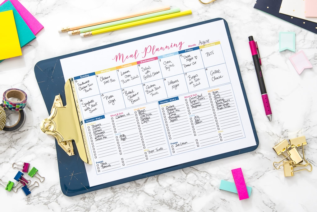 printable meal planner with text on a desk