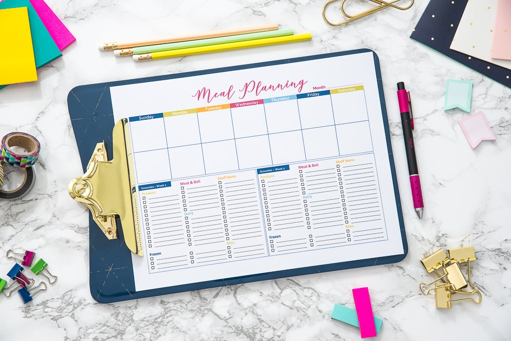 blank meal planning printable on a desk with accessories