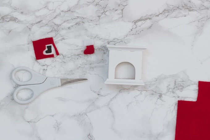 Look at this super cute mini Christmas fireplace ornament! I love how adorable it is - it's even got a tiny plate of cookies! Can't wait to make this for my tree!