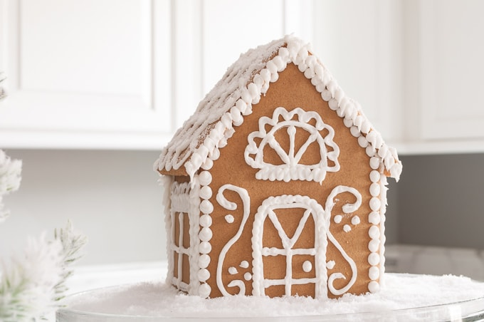 How to make a beautiful Christmas gingerbread house - the easy way. I love this all white wintry look. Great tips to learn how to create this pretty design.