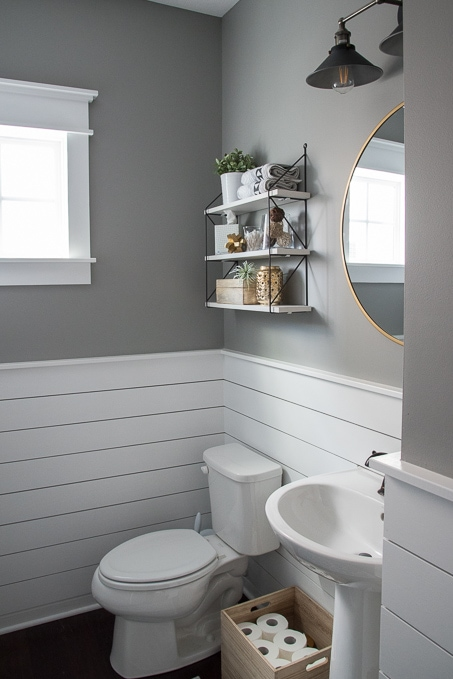 Check out this beautiful powder room reveal! This tiny bathroom was transformed from boring to fresh and modern! I love the shiplap and the modern classic decorations.