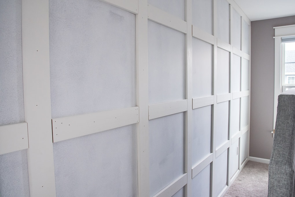 How to build a grid board and batten wall. Create a stunning feature wall for under $200! This wall looks like it was professionally built, but it was actually a home DIY project. Create a modern classic for your home.