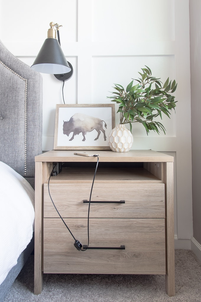 How to get rid of nightstand cable clutter. The best way to organize your wires and cords to create a charging station in your nightstand. Get rid of the mess once and for all!