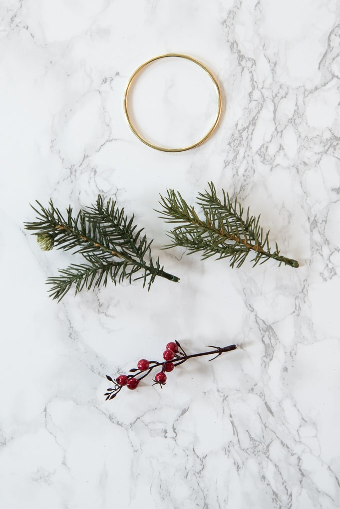 DIY Modern Christmas Wreath Ornament. Create this mini version of a modern gold wreath with faux greenery. Super easy tutorial for a cute ornament.
