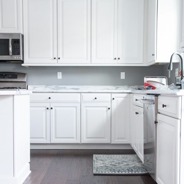 DIY soft close kitchen cabinets. Give your kitchen an instant upgrade by installing these soft close dampers on your cabinet doors. No more loud noises when you close your cabinets doors. This is such an easy and inexpensive DIY project.