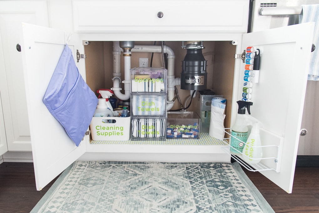 How to organize under the kitchen sink. Get rid of all the clutter and create a functional and beautiful organized cabinet. Learn exactly what organizing products to buy.