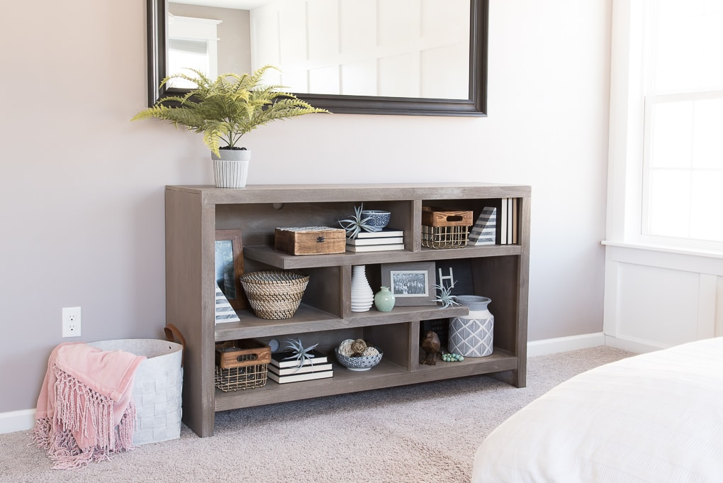 How to style bookshelves. Tips, tricks, and ideas for decorating shelves and bookcases with more than just books. Make your shelves look intentionally decorated and put together.