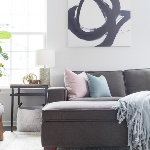 Come take a tour of our home decorated for spring! I'm excited to share a simple and bright spring living room tour. Pastel colors and natural elements make this room feel fresh for spring.