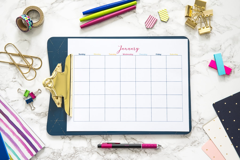 printable calendar on a clipboard with office supplies