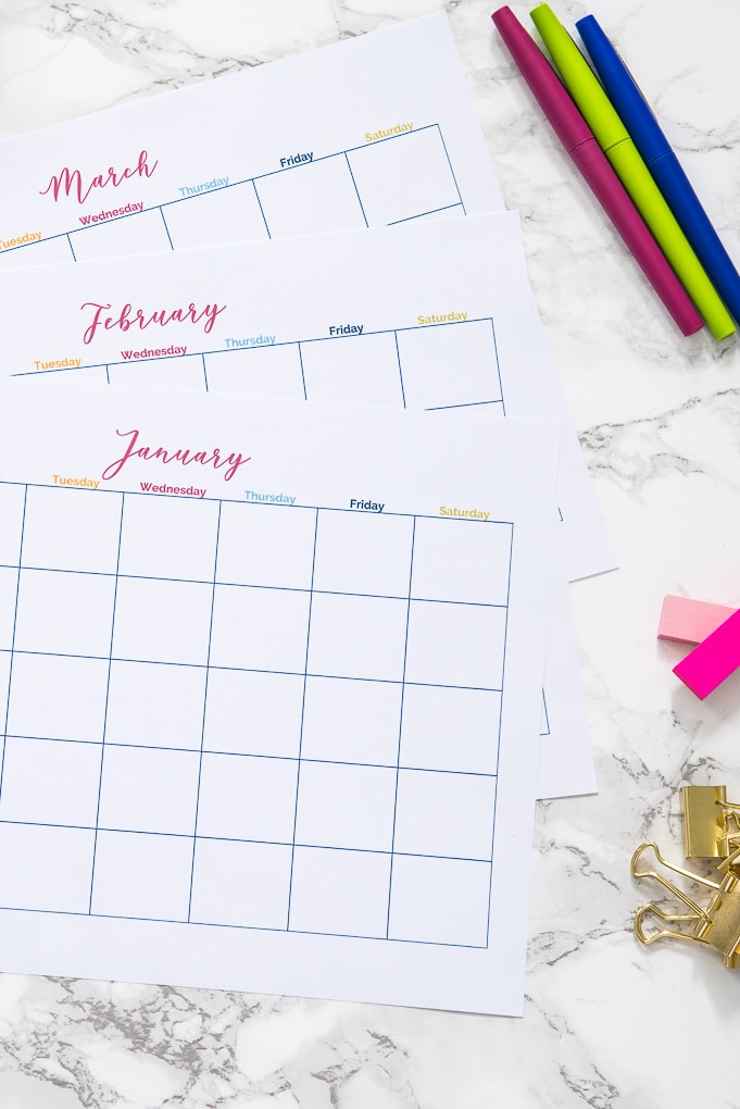 three months of printable calendars on a desk