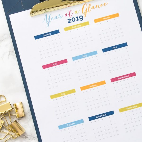 2019 year at a glance calendar printable on a clipboard