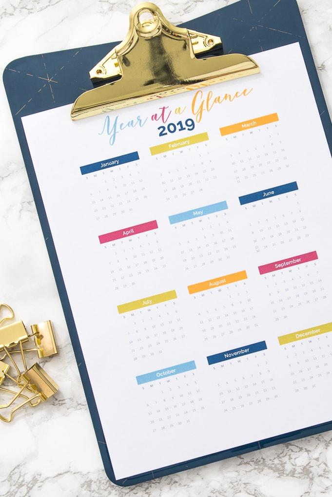 2019 year at a glance calendar printable on a clipboard