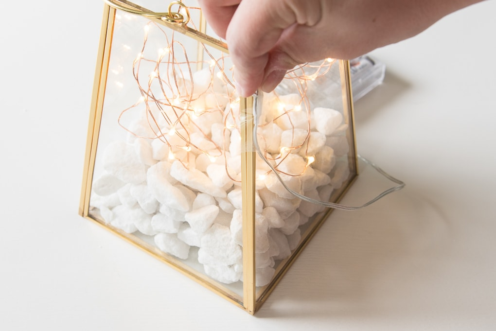 gold terrarium with fairy lights wire wrapping