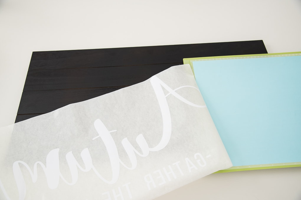 Cricut project using transfer tape to transfer a white vinyl design