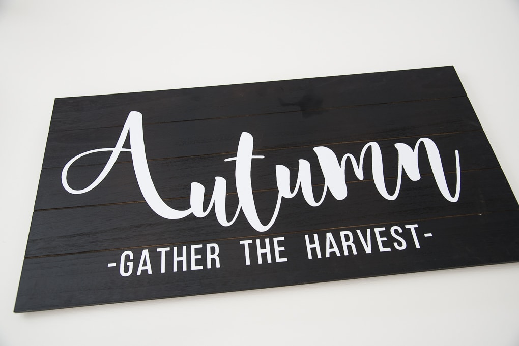 Black wooden pallet with a white vinyl design Autumn lettering
