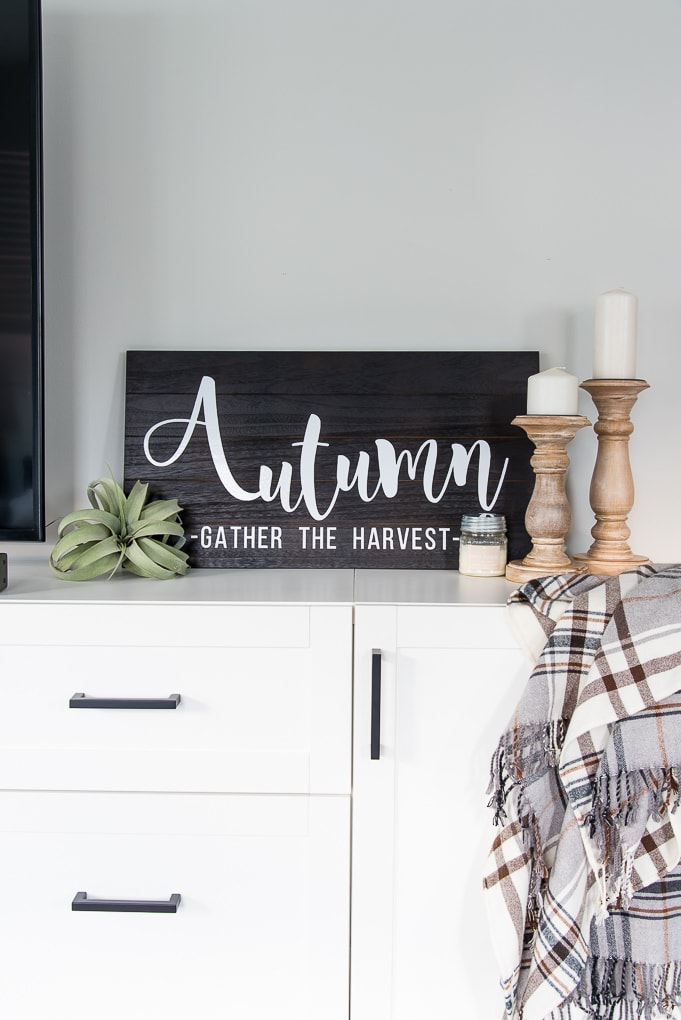 Wooden Autumn Hand-Lettered sign vignette on a media center with fall accessories