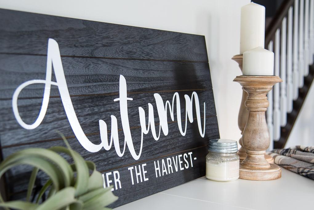 Closeup of Wooden Autumn Hand-Lettered sign vignette