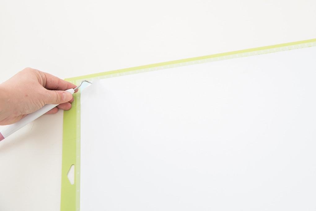 Cricut cutting mat with a white vinyl design