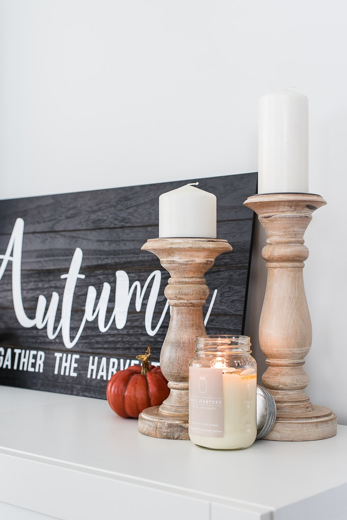 natural wooden candle holders and a fall harvest candle from antique candle works