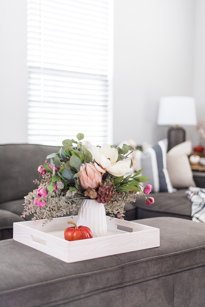 fall floral arrangement on a tray living room