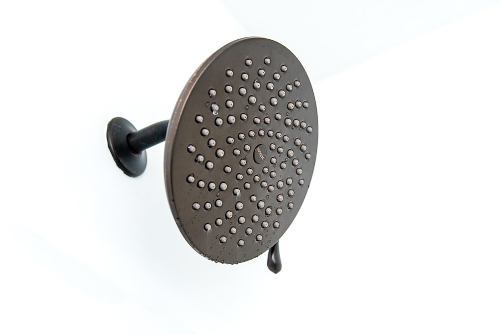 Close up of a Moen Velocity Shower Head in oil rubbed bronze