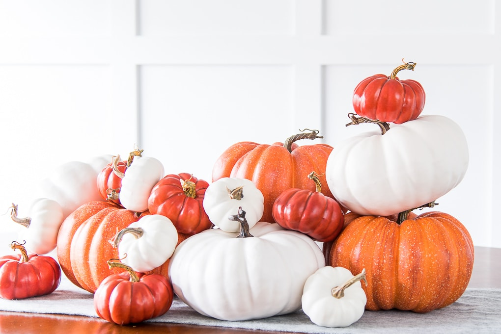pile of orange and white pumpkins stacked