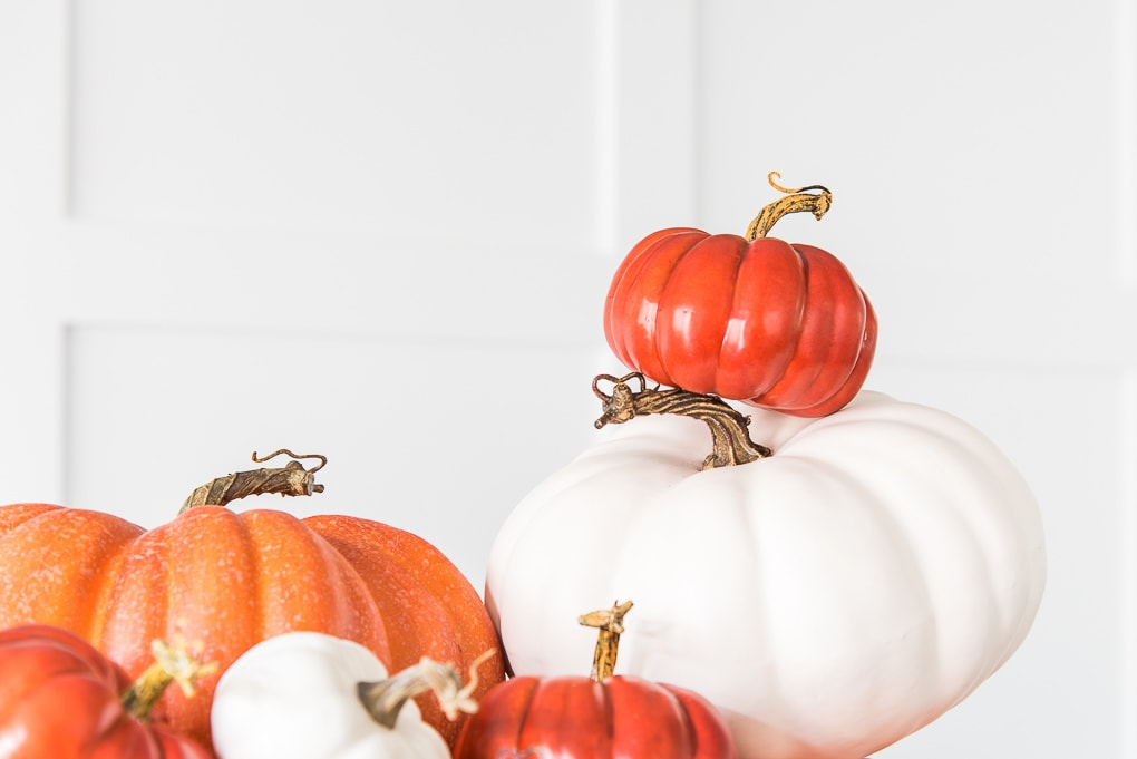 stacked orange and white pumpkins close up