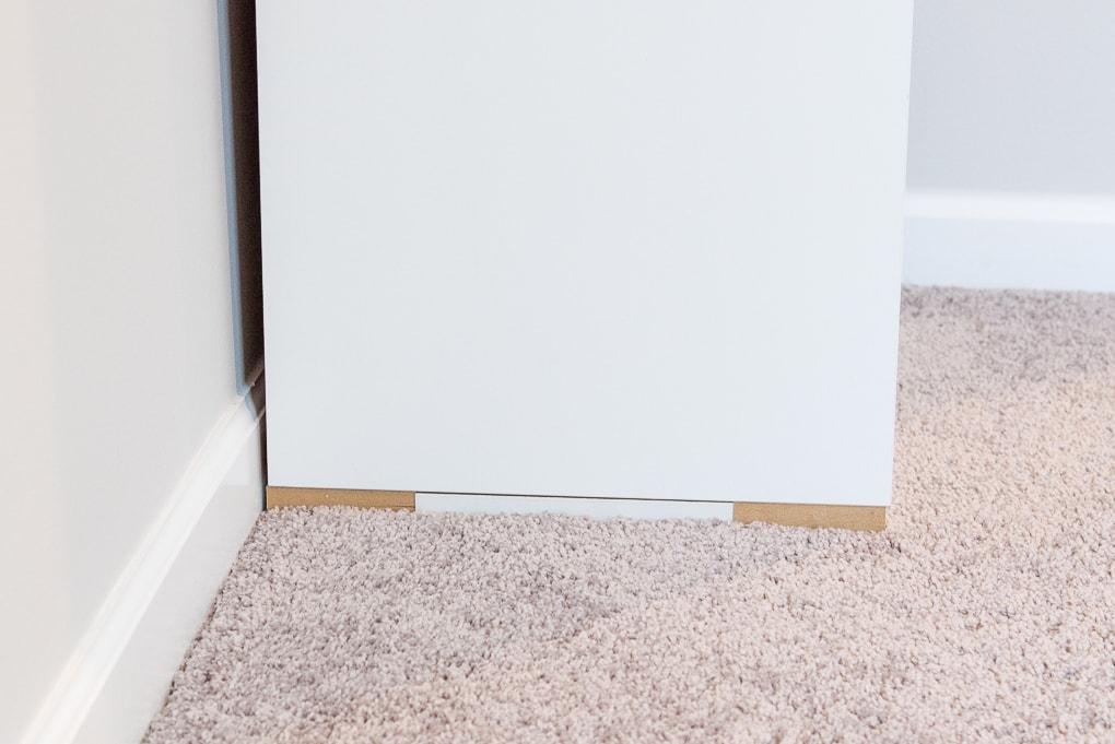 wooden frame base of an ikea sektion cabinet