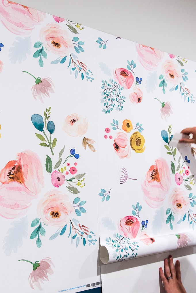 installing spoonflower floral removable wallpaper on a wall