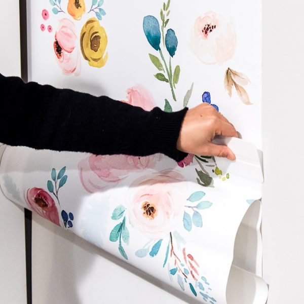 using a squeegee on removable wallpaper install