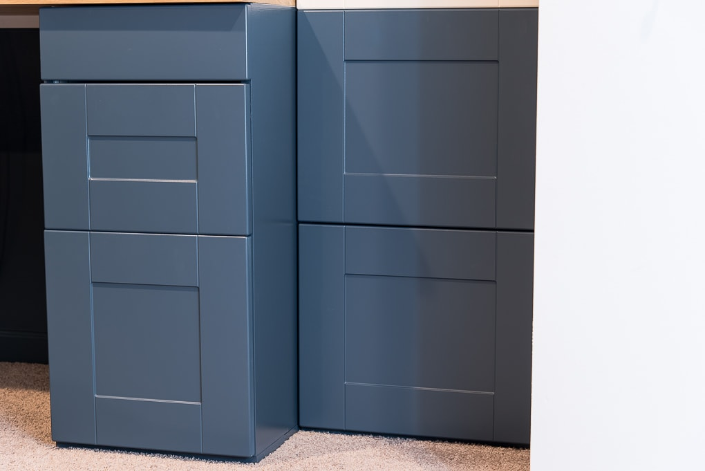 navy blue IKEA SEKTION cabinets installed in a built-in desk