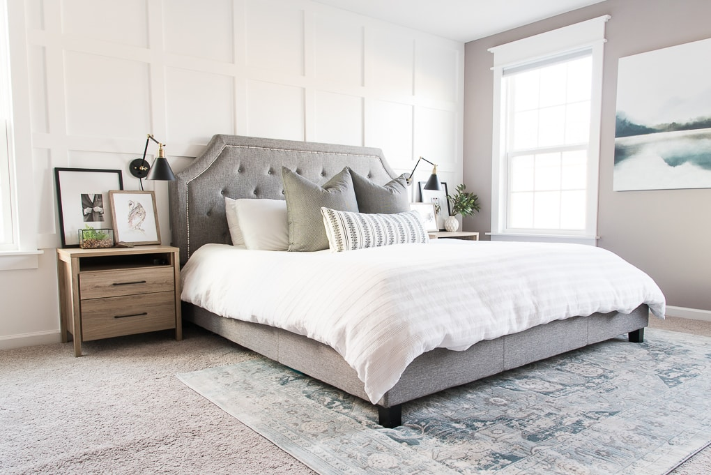 modern master bedroom with white bedding