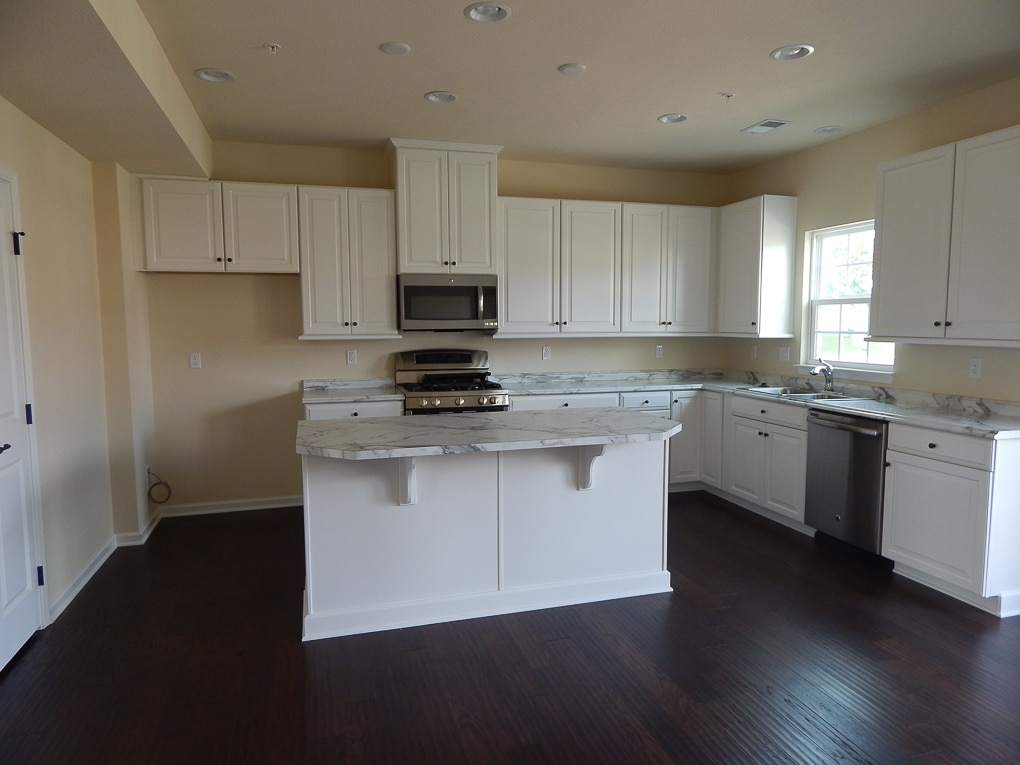 yellow and white empty kitchen builder grade home