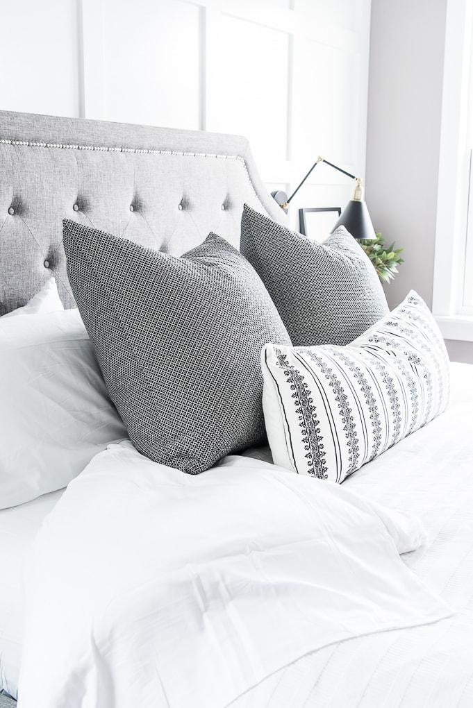 California Design Den white sheets bedding with black throw pillows