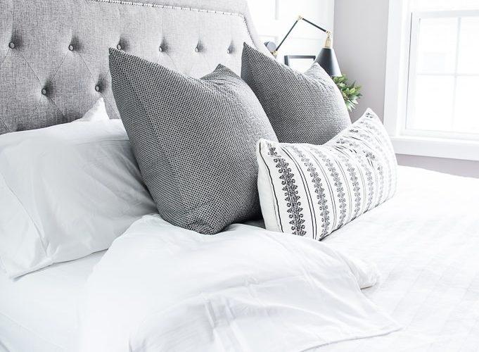 California Design Den white sheets bedding master bedroom close up