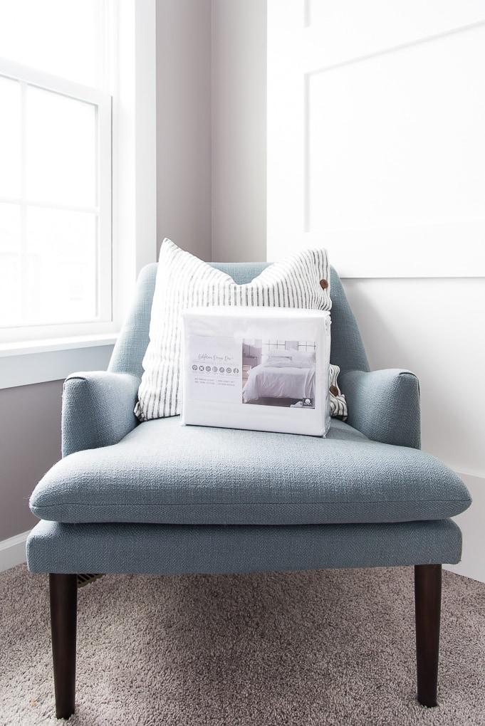California Design Den Sheets set on a blue chair